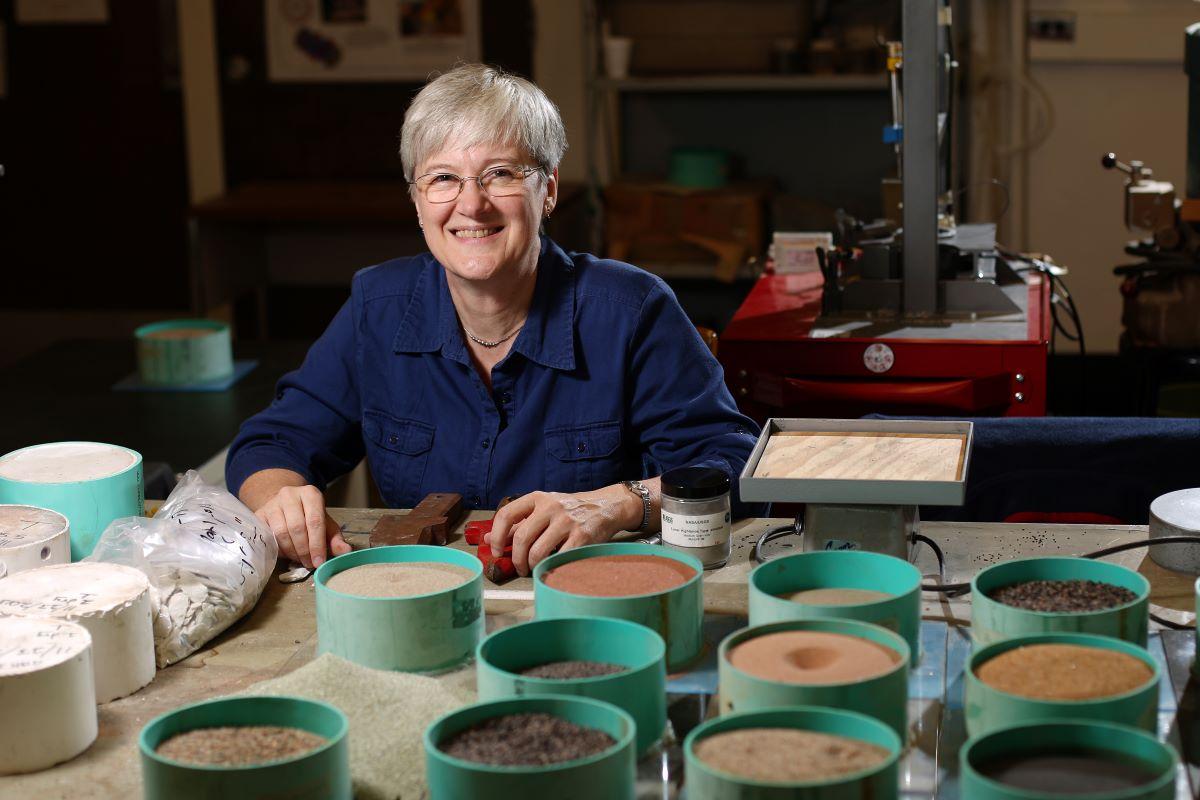 Dr. Leslie Gertsch with meteorite samples in her lab