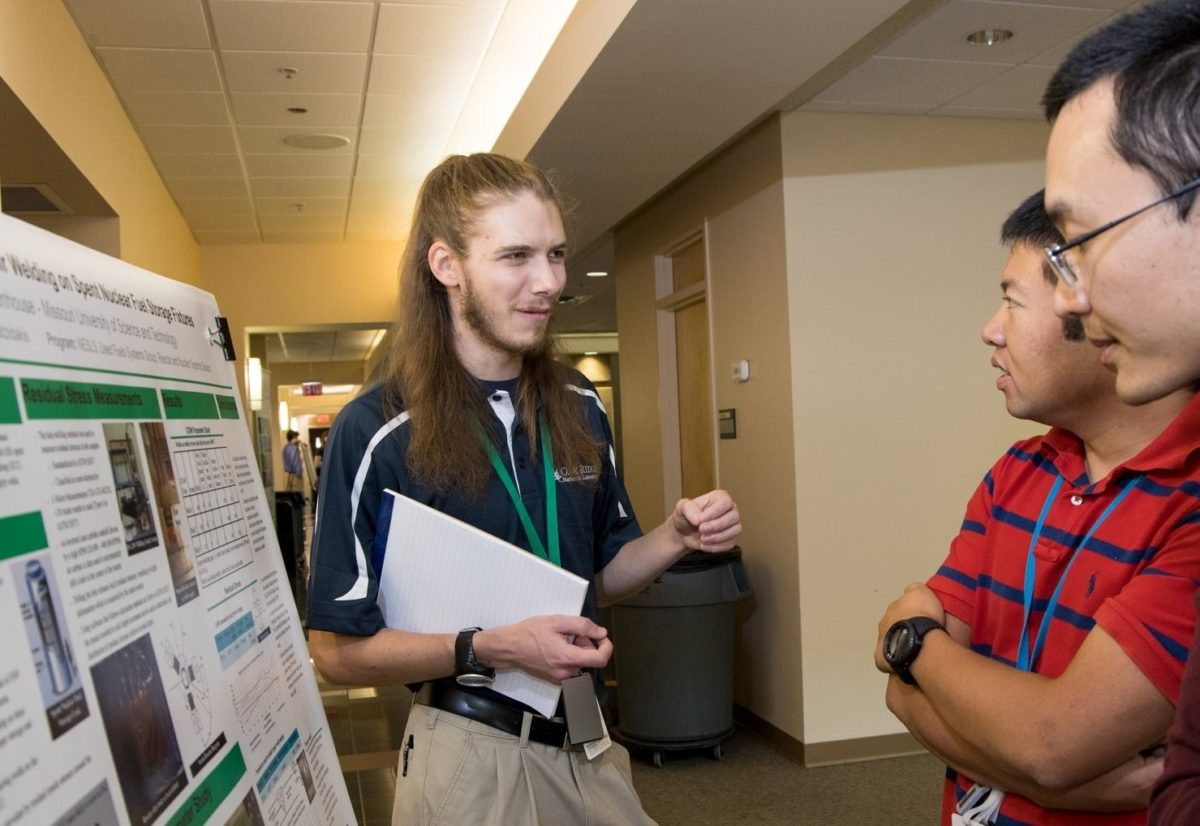 Joshua Rittenhouse at a poster presentation