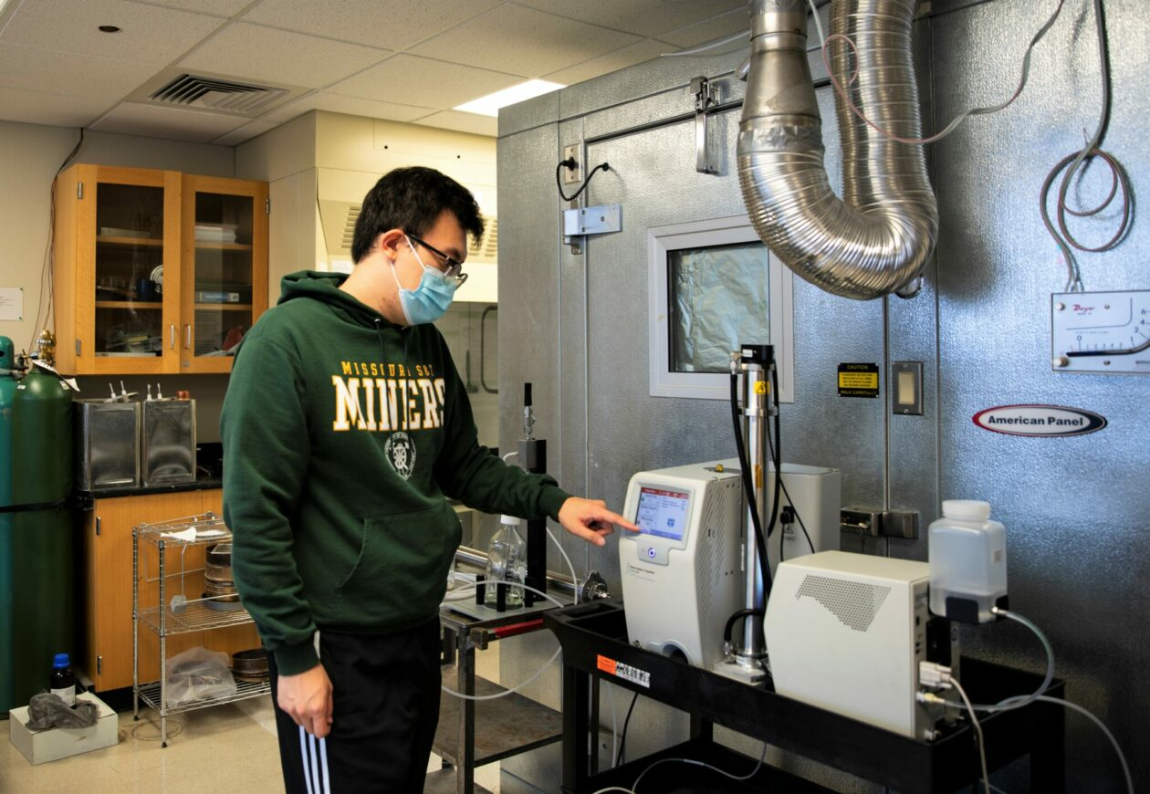 Photo of Ph.D. student Weixing Hao working at the lab used to study bioaerosols