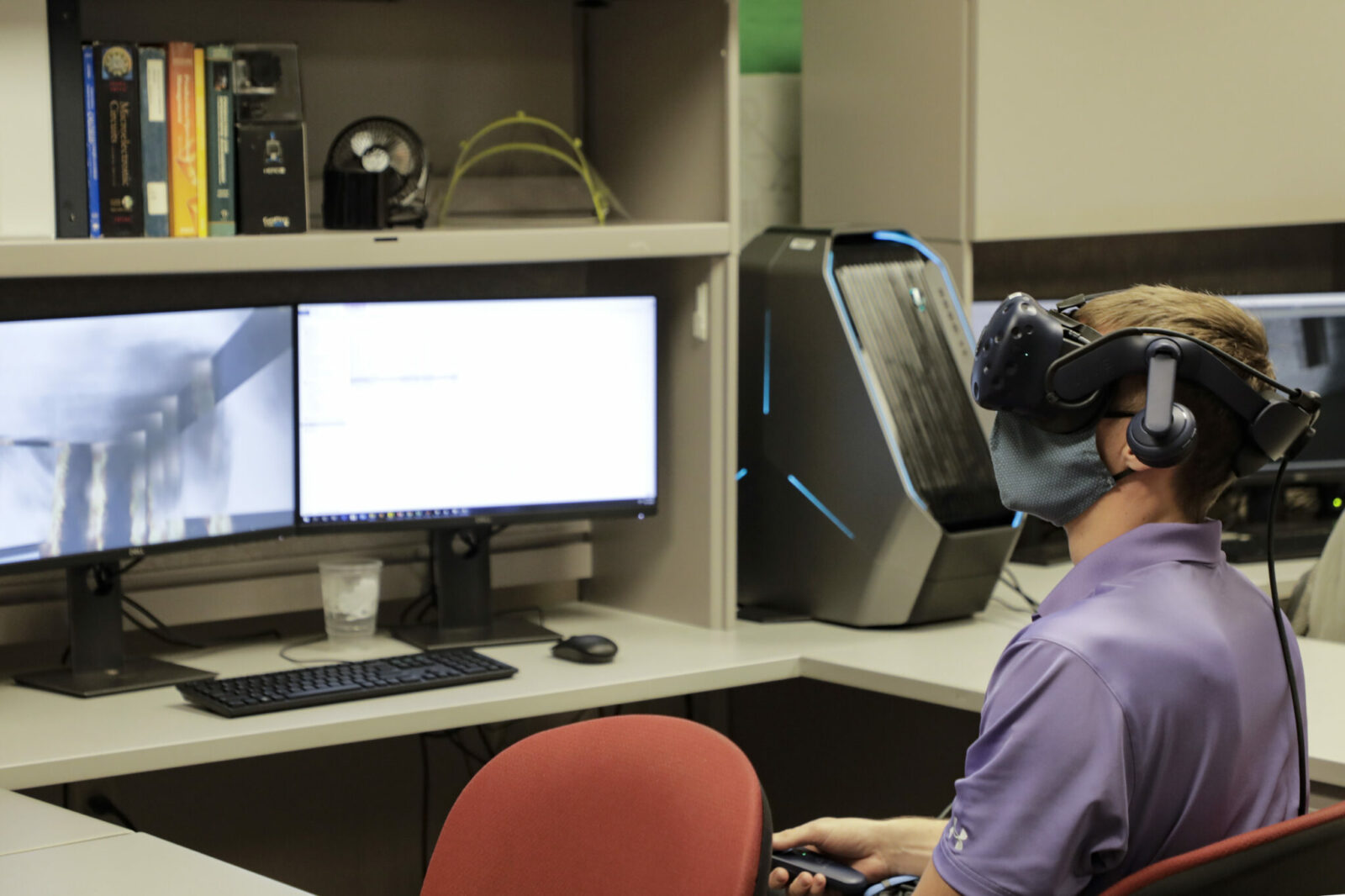 Photo of student in virtual reality lab