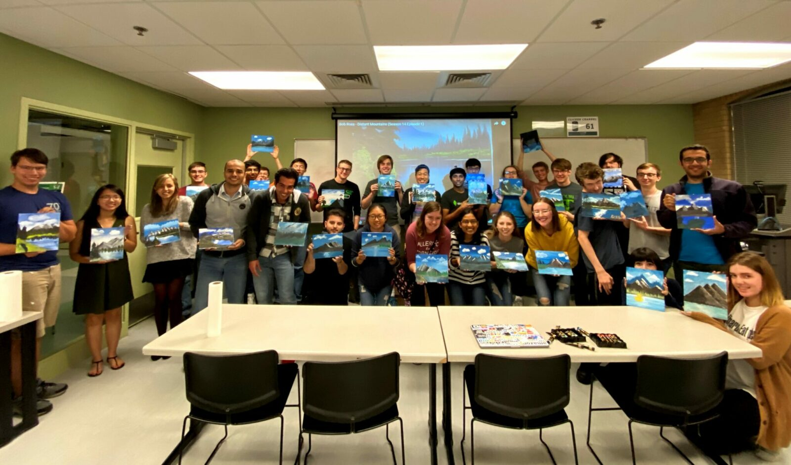 Photo of ACM students on a Bob Ross painting night