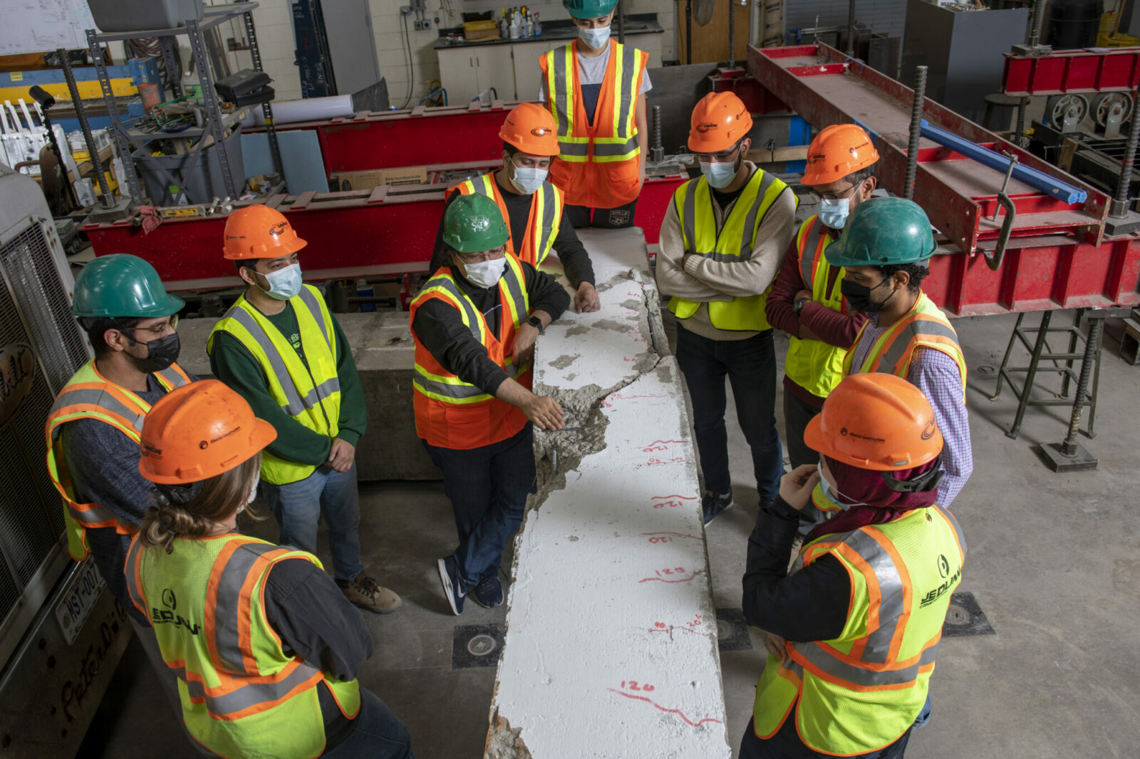 Dr. ElGawady and students investigating damaged concrete girder