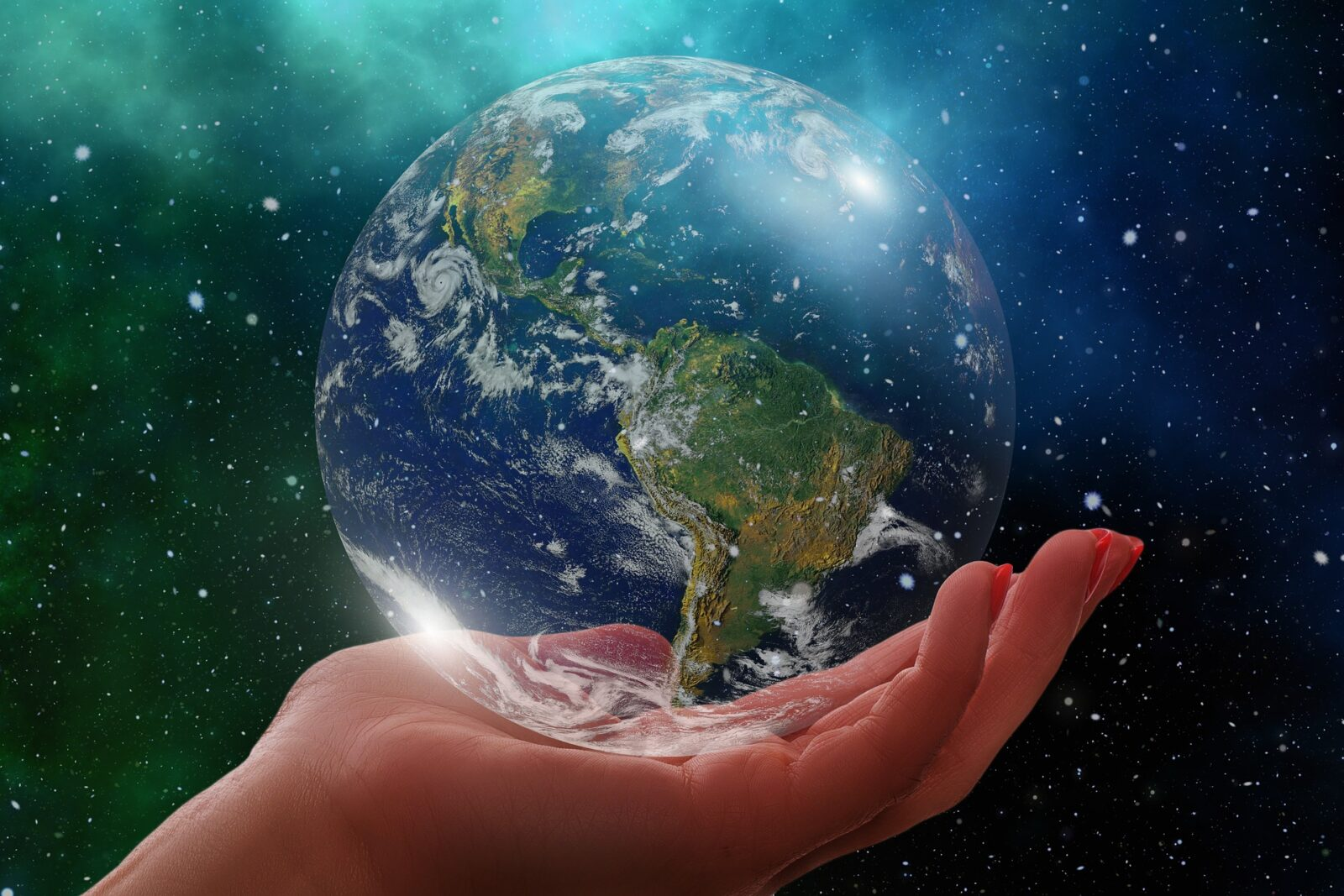 Hand holding a transparent globe