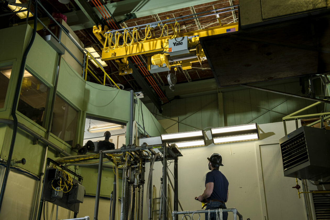 Photo of nuclear engineering students with new crane
