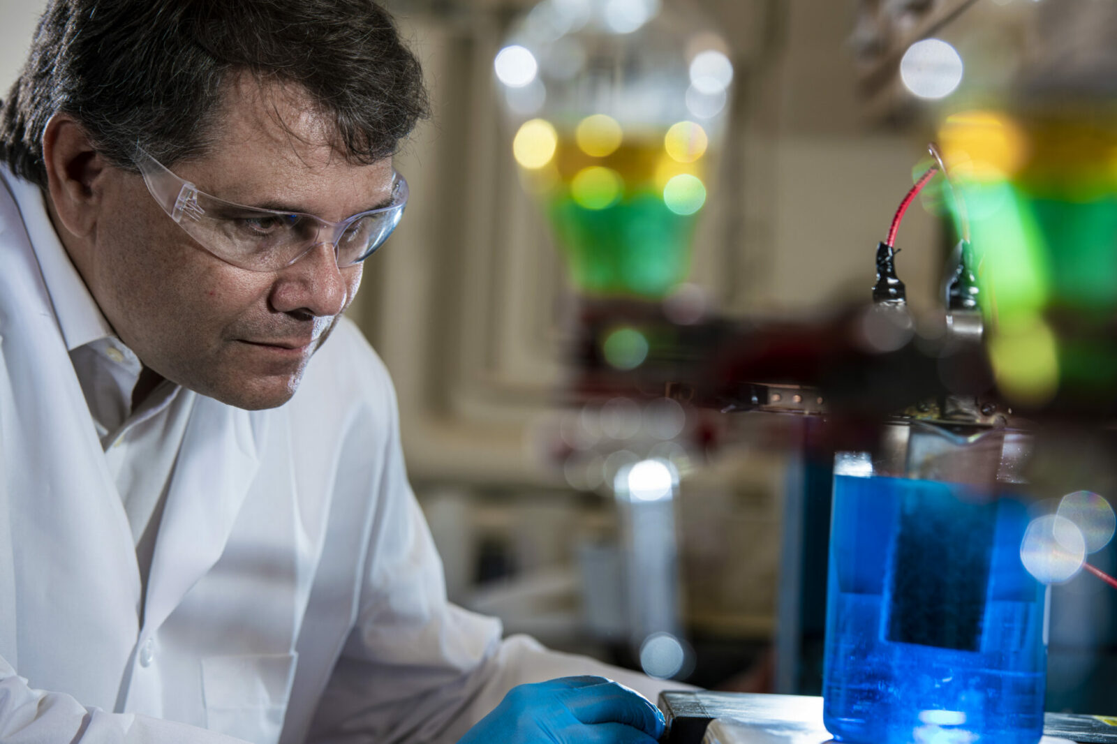 Photo of Dr. Michael Moats conducting research in lab