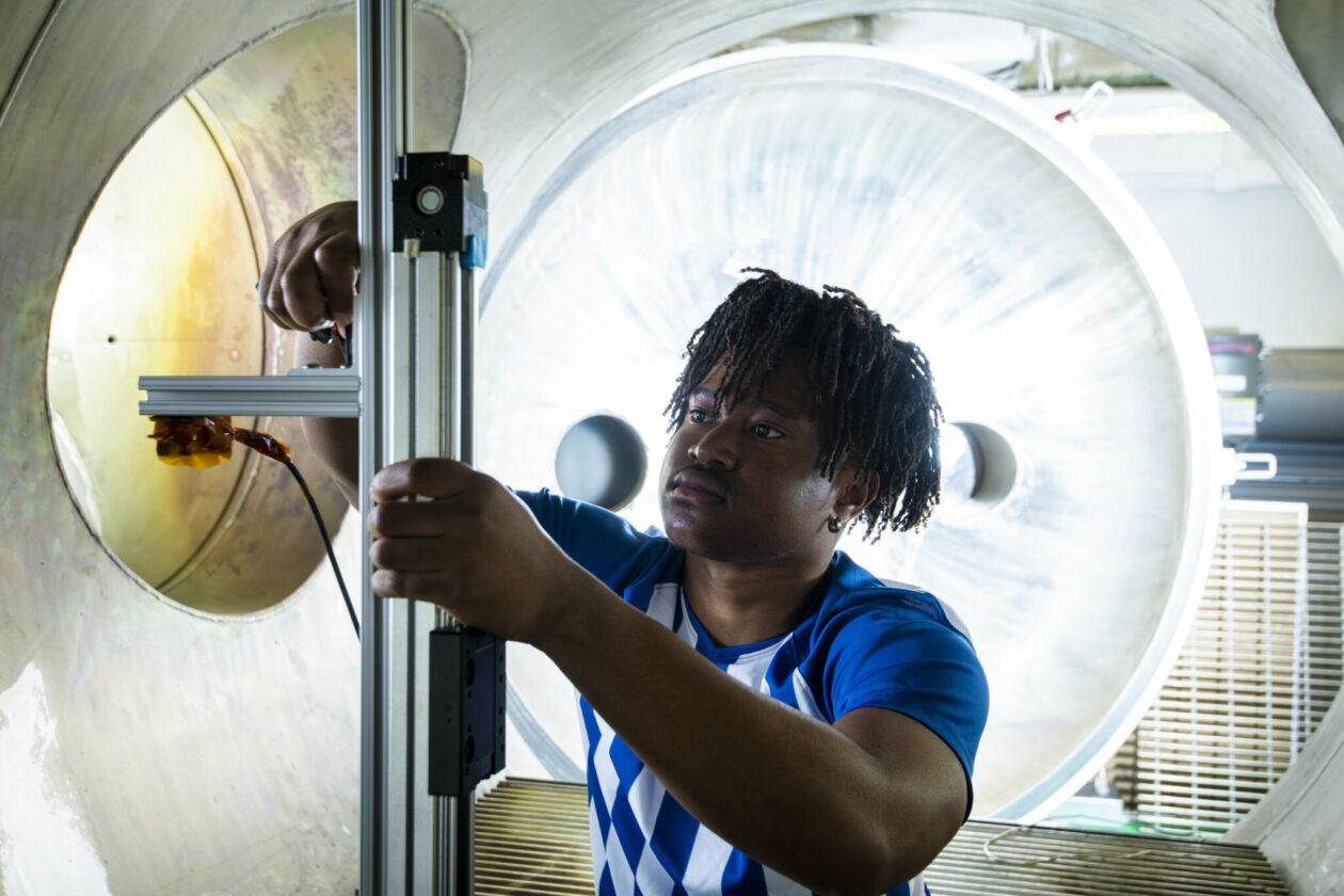 Photo of student in plasma vacuum chamber