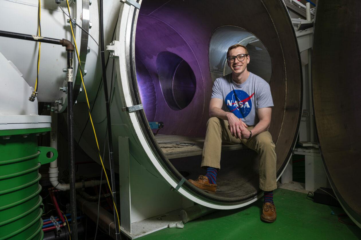 Photo of David Lund with plasma vacuum chamber at Missouri S&T