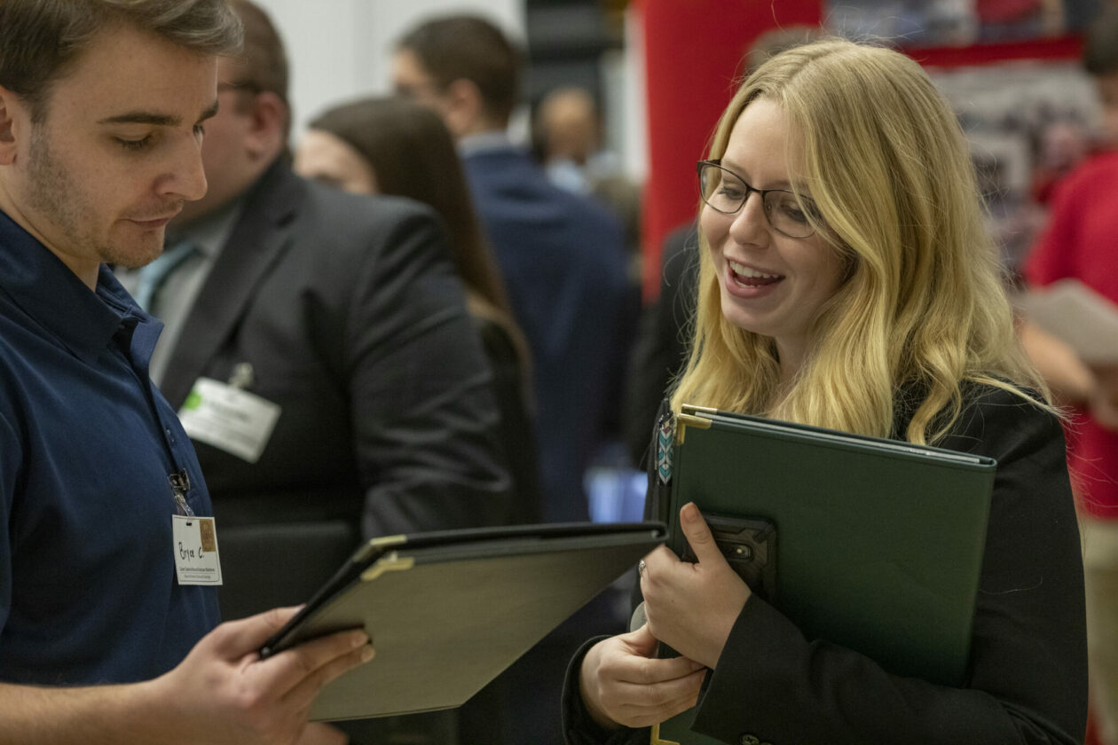 Photo of student talking with business representative at Missouri S&T Career Fair