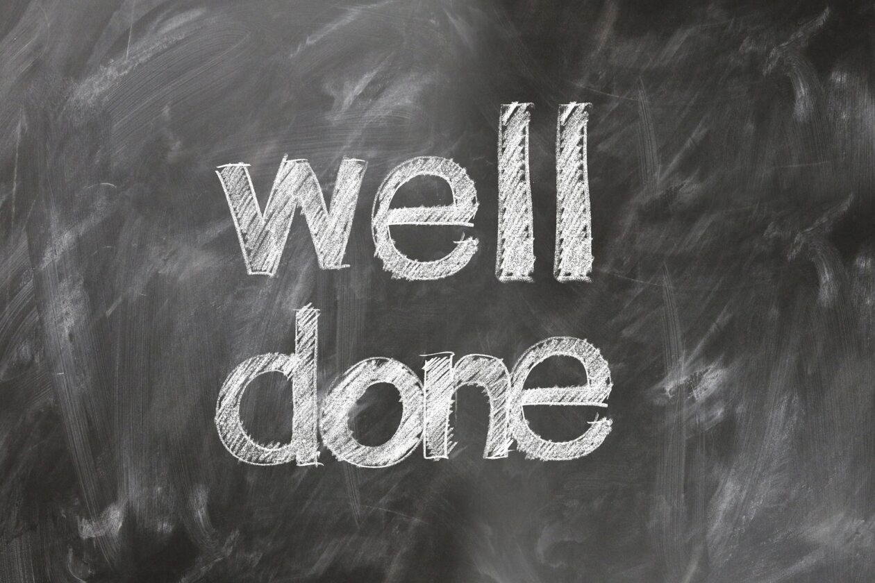 Image of blackboard with the words well done